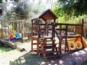 מותאם לילדים: צימרים עם משחקי חצר